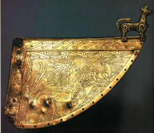 Viking weather-vane: Ringerike style- Scandinavia. The Ringerike style grew out of the Mammen style during the first half of the 11th century. Wolf ornament on Viking ship Weather vane 11th Century CE. Heggen, Norway.