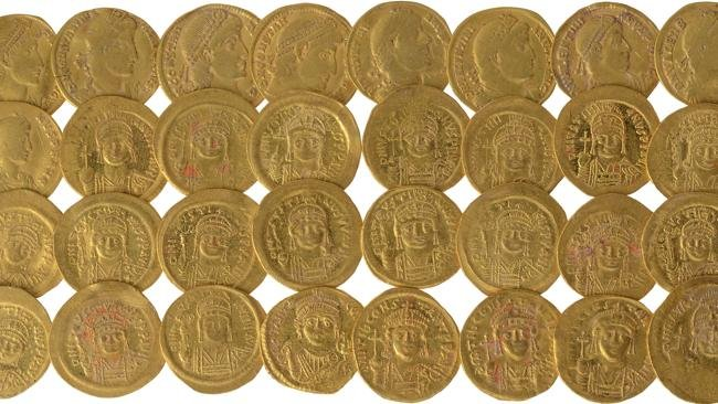 Gold coins found at foot of Temple Mount in Jerusalem: These thirty-six gold coins were discovered in Hebrew University excavations at the foot of the Temple Mount in Jerusalem. The coins can be dated to the reigns of different Byzantine emperors, ranging from the middle of the fourth century CE to the early seventh century CE. Also found in the excavations were a 10-cm gold medallion etched with a Temple candelabrum, ram's horn and Torah scroll, as well as gold and silver jewelry. (Photo by Ouria Tadmor)