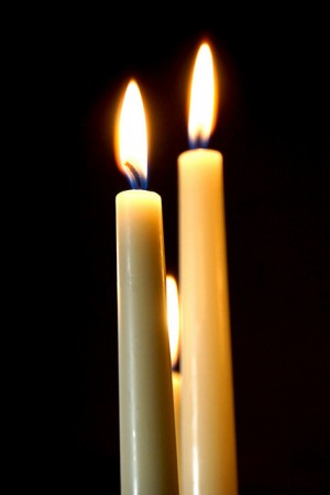 candle flames - photo by Dennis Jarvis