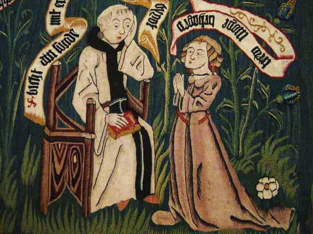 Medieval priest giving confession