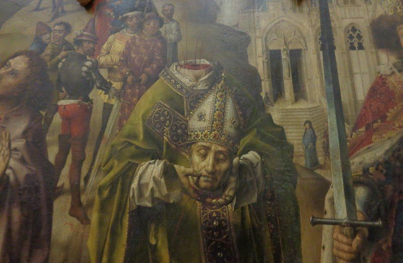 St Denis holding his head - an oil on panel painting - photo by Danielle Trynoski