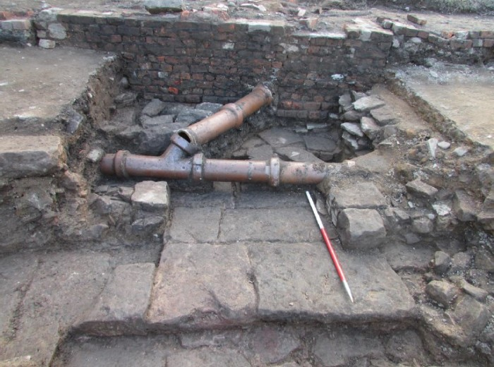A flagstone floor under the remains of 19th Century houses on Tower Street.