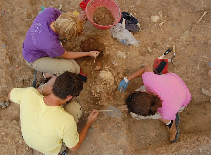 Field School students excavate human remains buried in the post-medieval churchyard at Badia Pozzeveri - photo courtesy Ohio State University