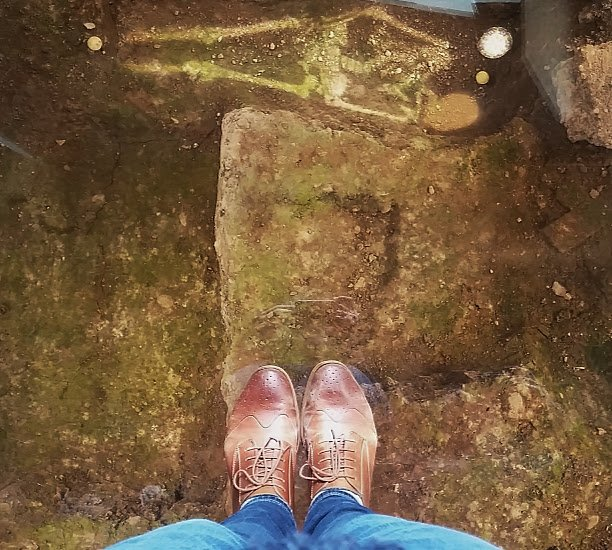 Standing over the spot Richard III was discovered at the King Richard III Visitor's Centre in Leicester. Photo by Medievalists.net