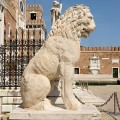 The First lion standing at the left side of the Door land the Arsenal of Venice is ancient Greek sculpture, originally at the Piraeus in Athens, brought to Venice by Francesco Morosini, who conquered the Peloponnesus. Photo by Didier Descouens / Wikipedia