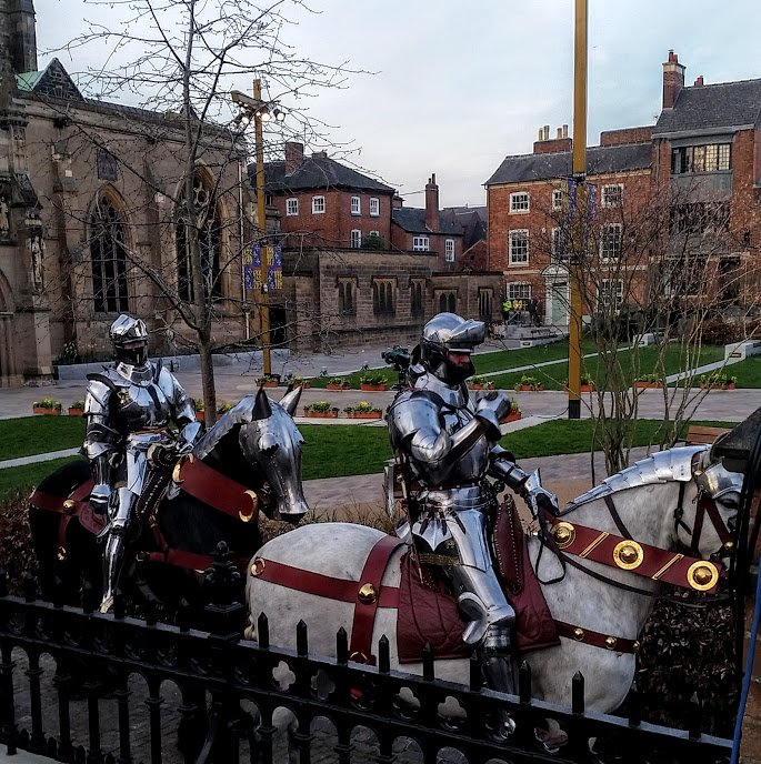 Tobias Capwell (black horse), and fellow jouster, Dominic Sewell escorted King Richard III to his final resting place in Leicester Cathedral this past March. Photo by Medievalists.net