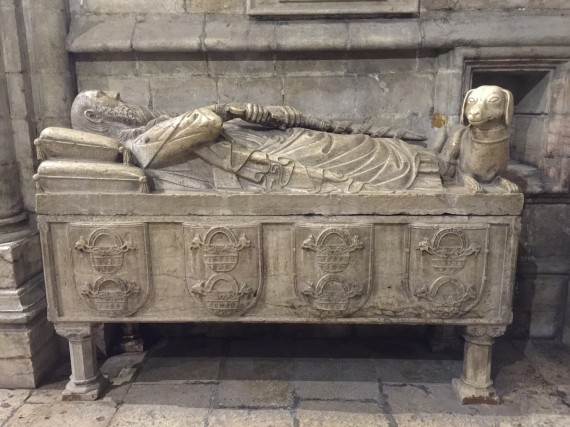 14th century tomb of Lopo Fernandes Pacheo, the 7th Lord of Ferreira, holding a sword with his dog at his feet. Photo by Medievalists.net