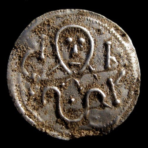 "A coin from King Harald Bluetooth, about 975 to 980"". Photographed just as it came out of the earth. Photo: Tobias Bondesson / Museum Vestsjælland"
