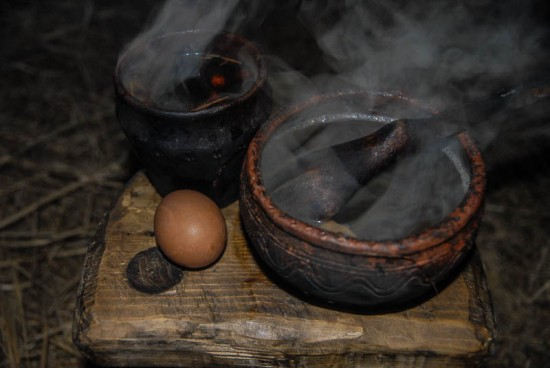 Pavel Sapozhnikov cooking food as it would have been made in the ninth century. Photo courtesy of Alone in the Past.